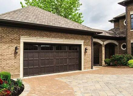 Home with wood garage door